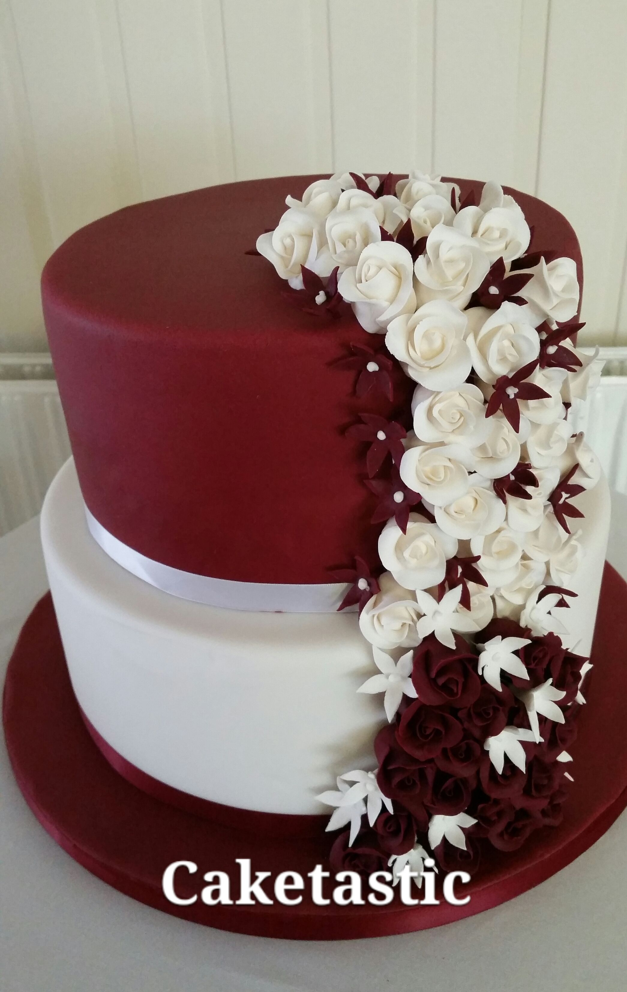 2 Tier Ivory And Burgandy Wedding Cake With Roses Cascading
