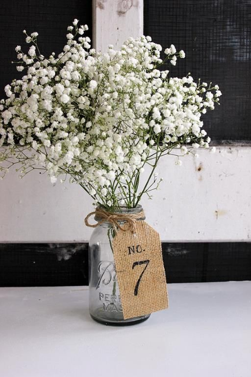 easy table center pieces - flower of choice - vintage jar - tags