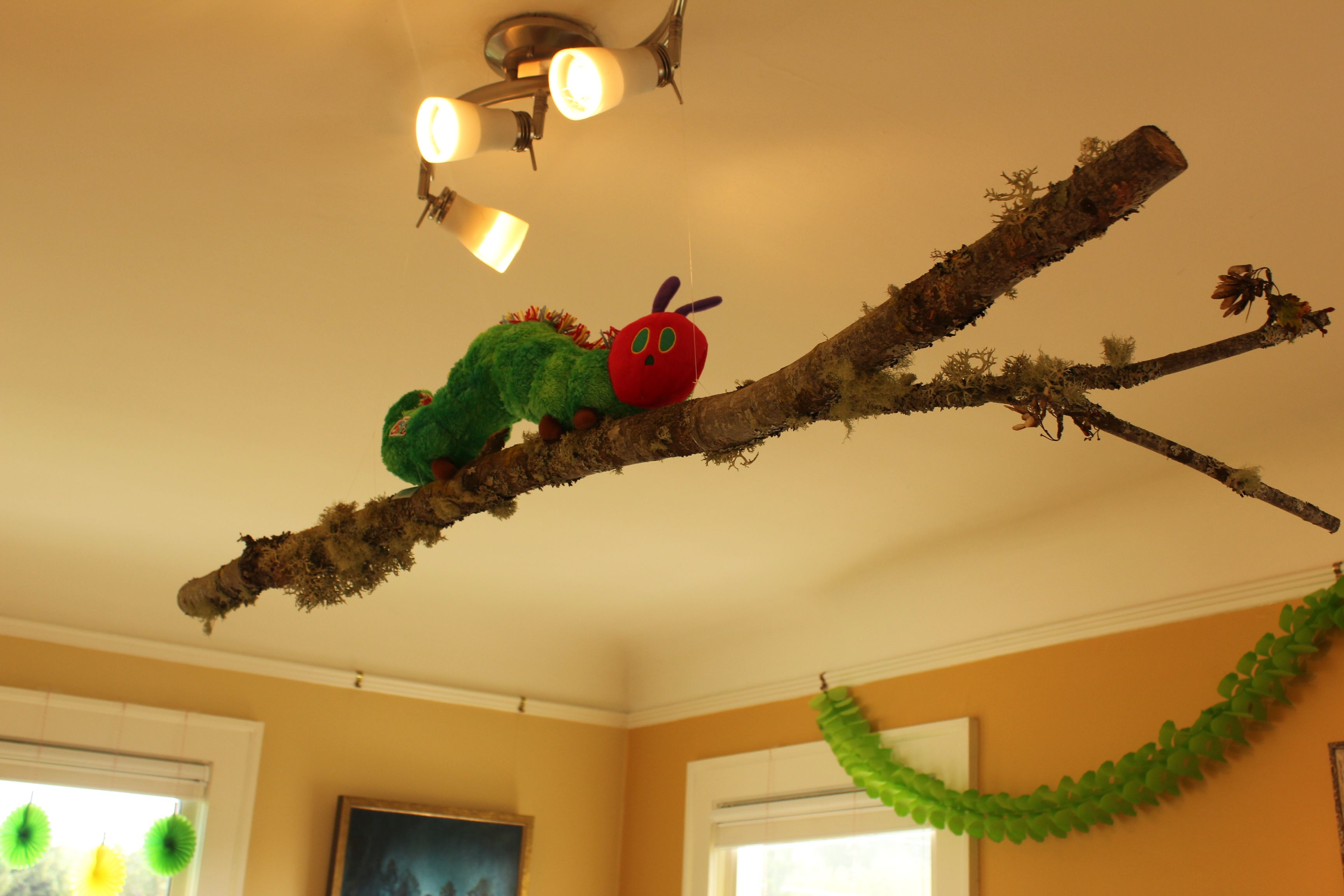 Stick from Sinclair, attach caterpillar and hung with fish wire to ...