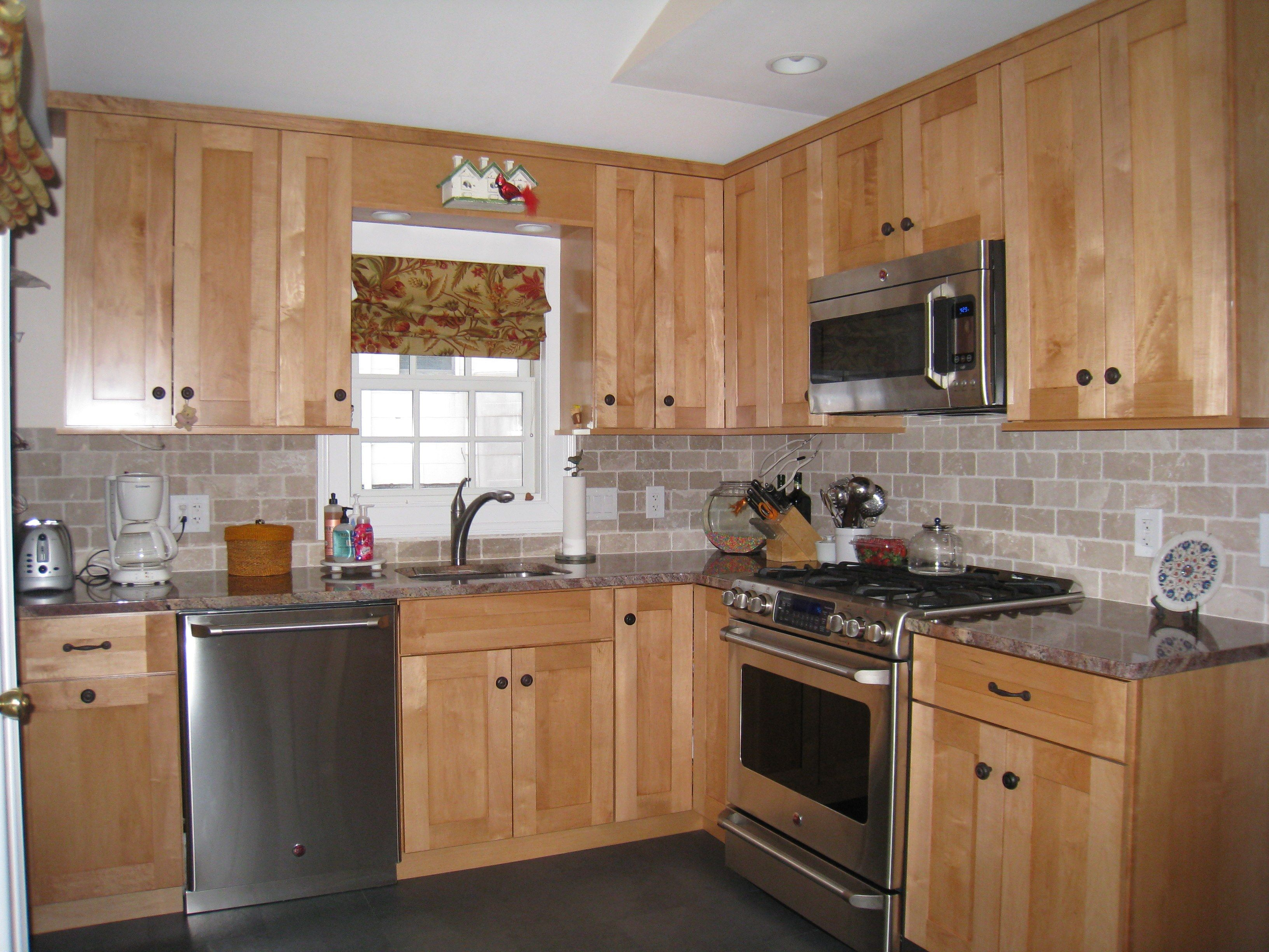 Glorious Maple Kitchen Cabinets With White Pattern Subway Wall Stone