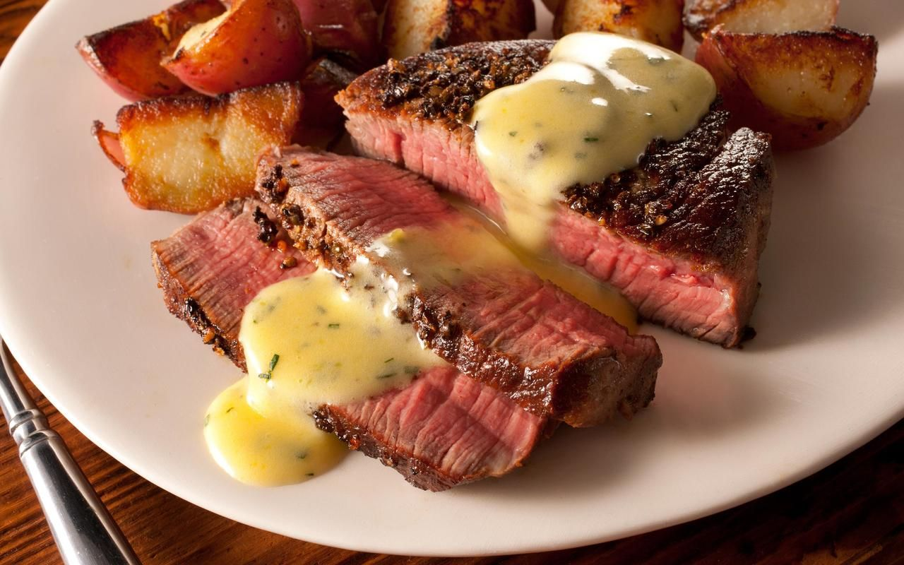 Rubbed with black and green peppercorn butter, then seared.