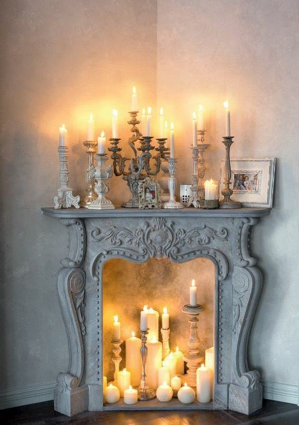 Decorative fireplace  romantic mood with candles and lanterns  deco chimney candlestick long candles mantel