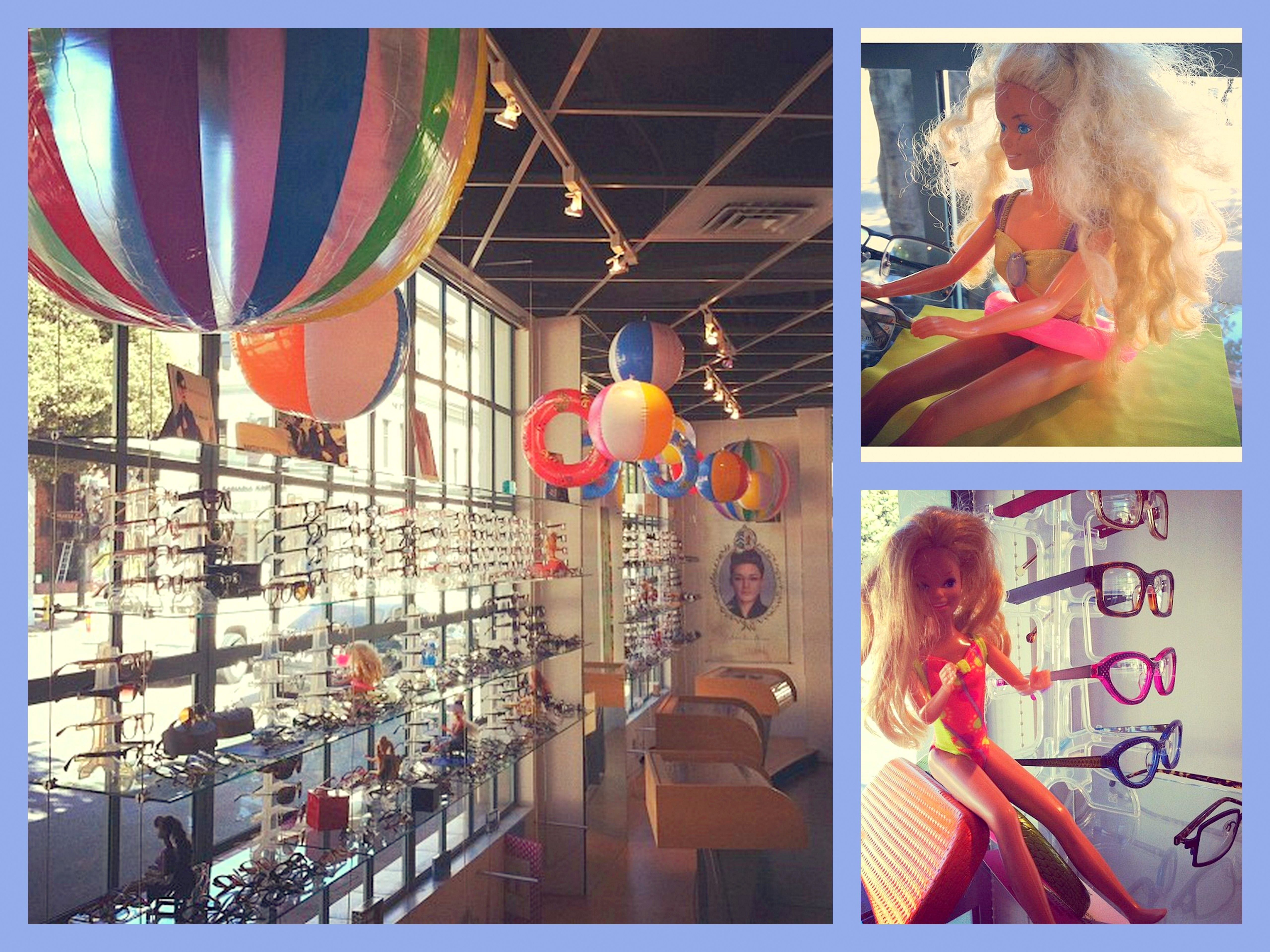 Summer window display, floating beach balls and bathing ...