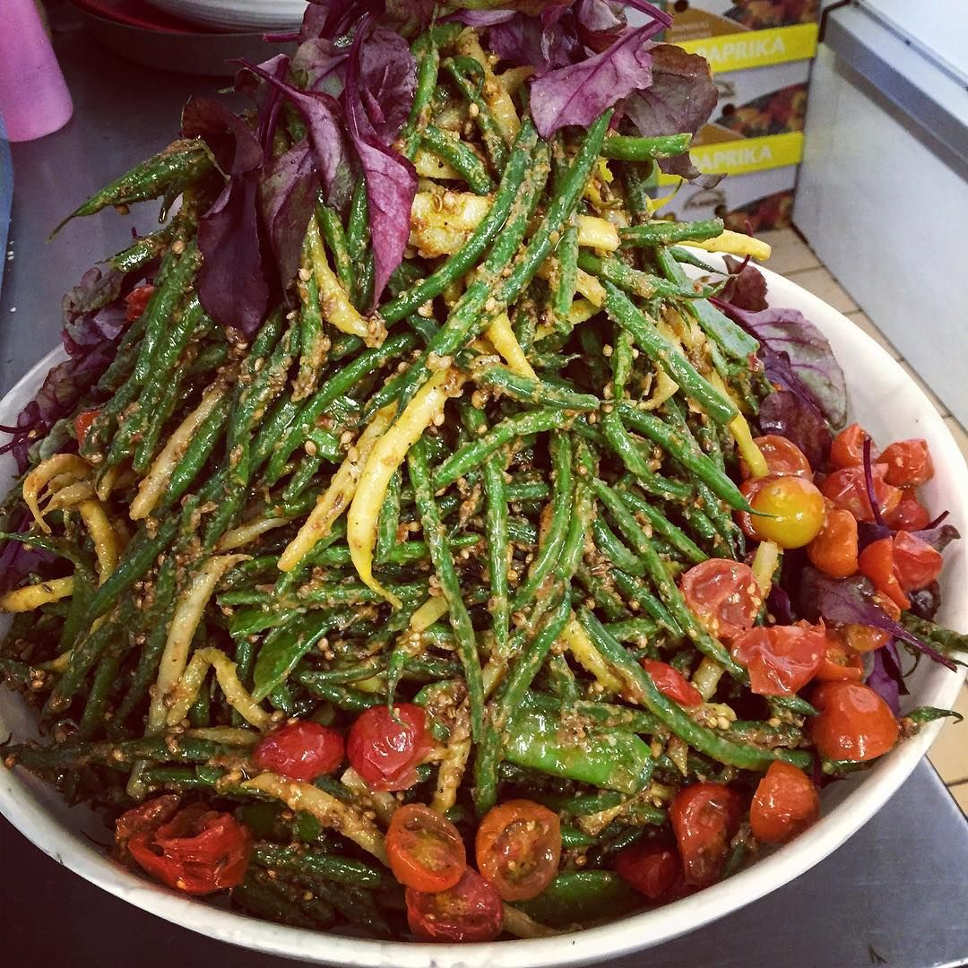 Just a pile of beans at #OttolenghiIslington   #YotamOttolenghi  Grilled beans and tomatoes