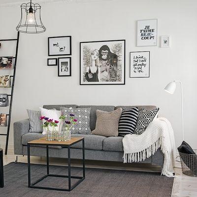 Sof gris con manta de lana sal n decoraci n cuadros - Decoracion paredes grises ...