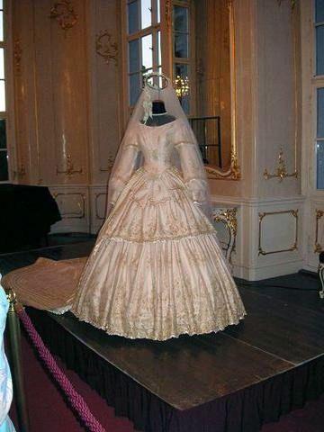 Empress Elisabeth of Austria's wedding dress; below an ...