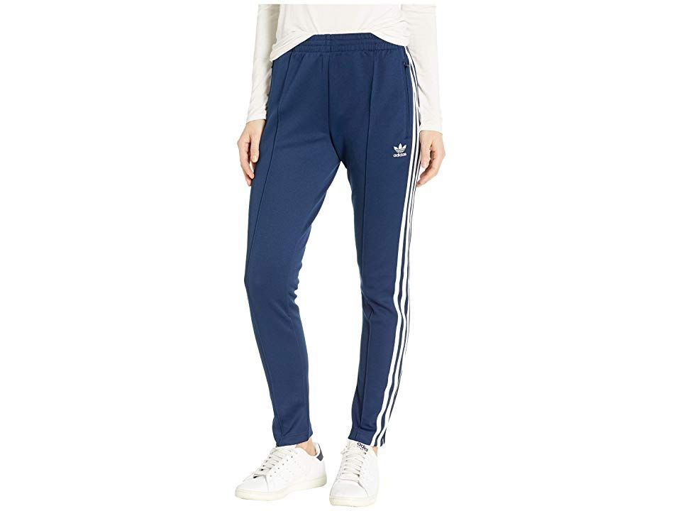 adidas Originals SST Track Pants Collegiate Navy Womens Workout Maintain your authenticity in this sportsinspired look Slim fit is snug on hips and styles Elastic waistba...