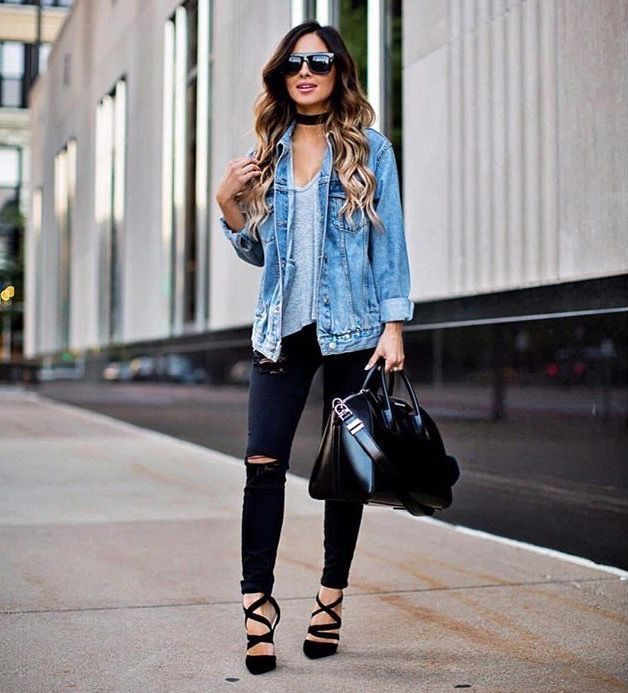 e38fcef1e2 Denim jacket over blue top with trendy distressed jeans