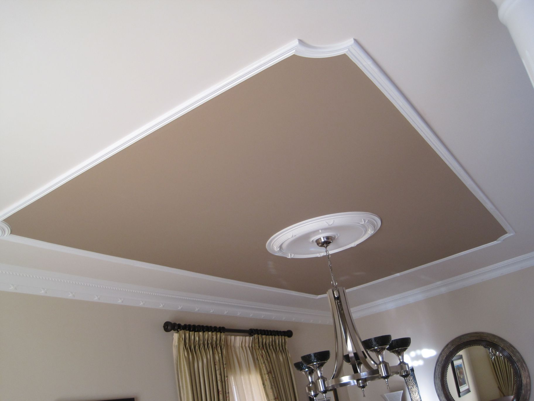 Baseboard used on ceiling and moulding on ceiling here for Bathroom ceiling design