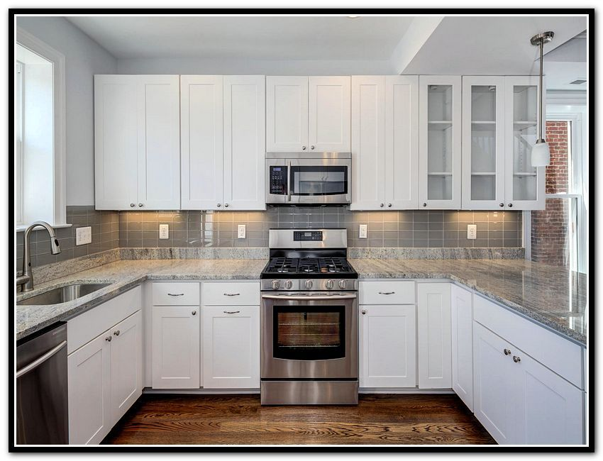 Stone Kitchen Backsplash With White Cabinets white kitchen cabinets stone backsplash | new house - kitchen