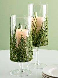 elegant winter centerpieces...wine glass, greens from the back yard, votive candles...lovely