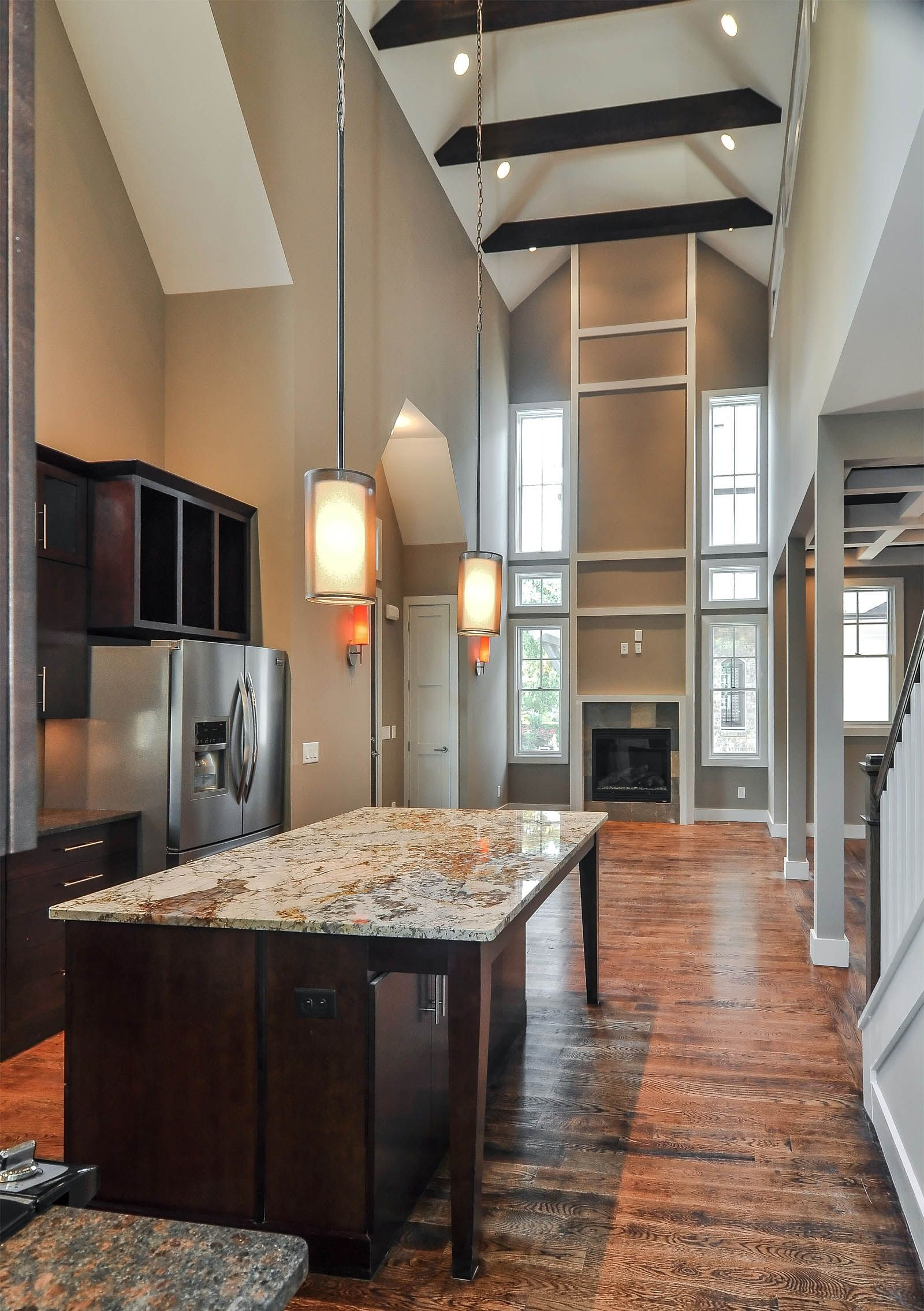 Open kitchen and living room in a double height, vaulted ...