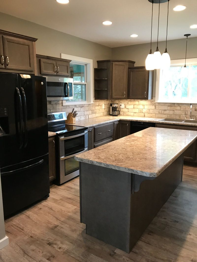 Wellborn Cabinet Inc Essex Maple Drift Cabinets With Wilsonart Autumn Carnival Tops And Cantina Marble Countertops Dark Cabinets Kitchen Kitchen Installation