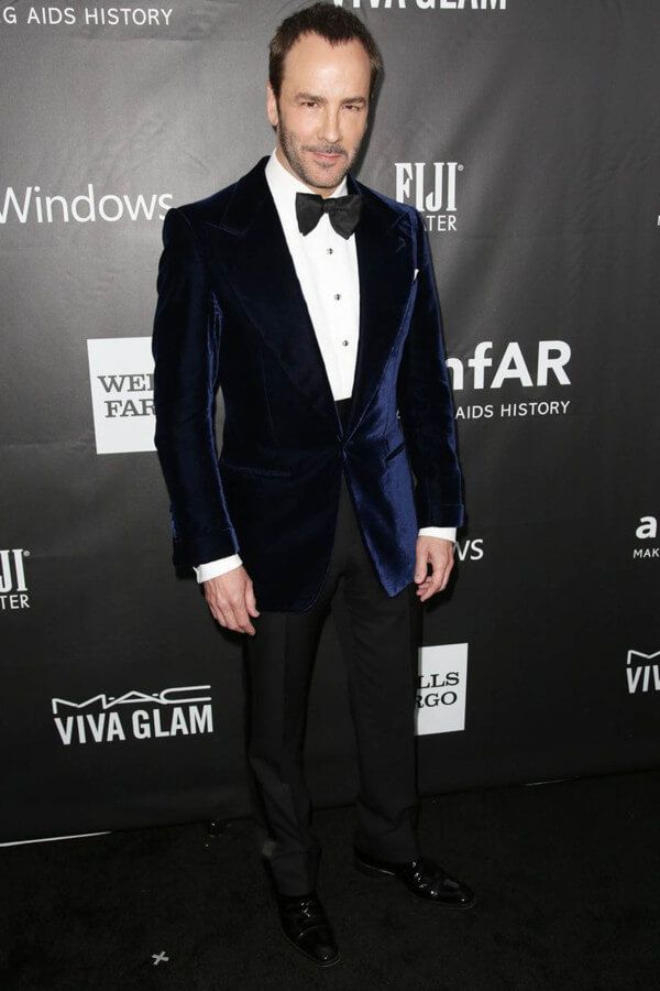 Tom Ford wearing a velvet smoking jacket