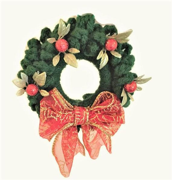 Photo of Crocheted Wreath Package Trim with Red Ribbon