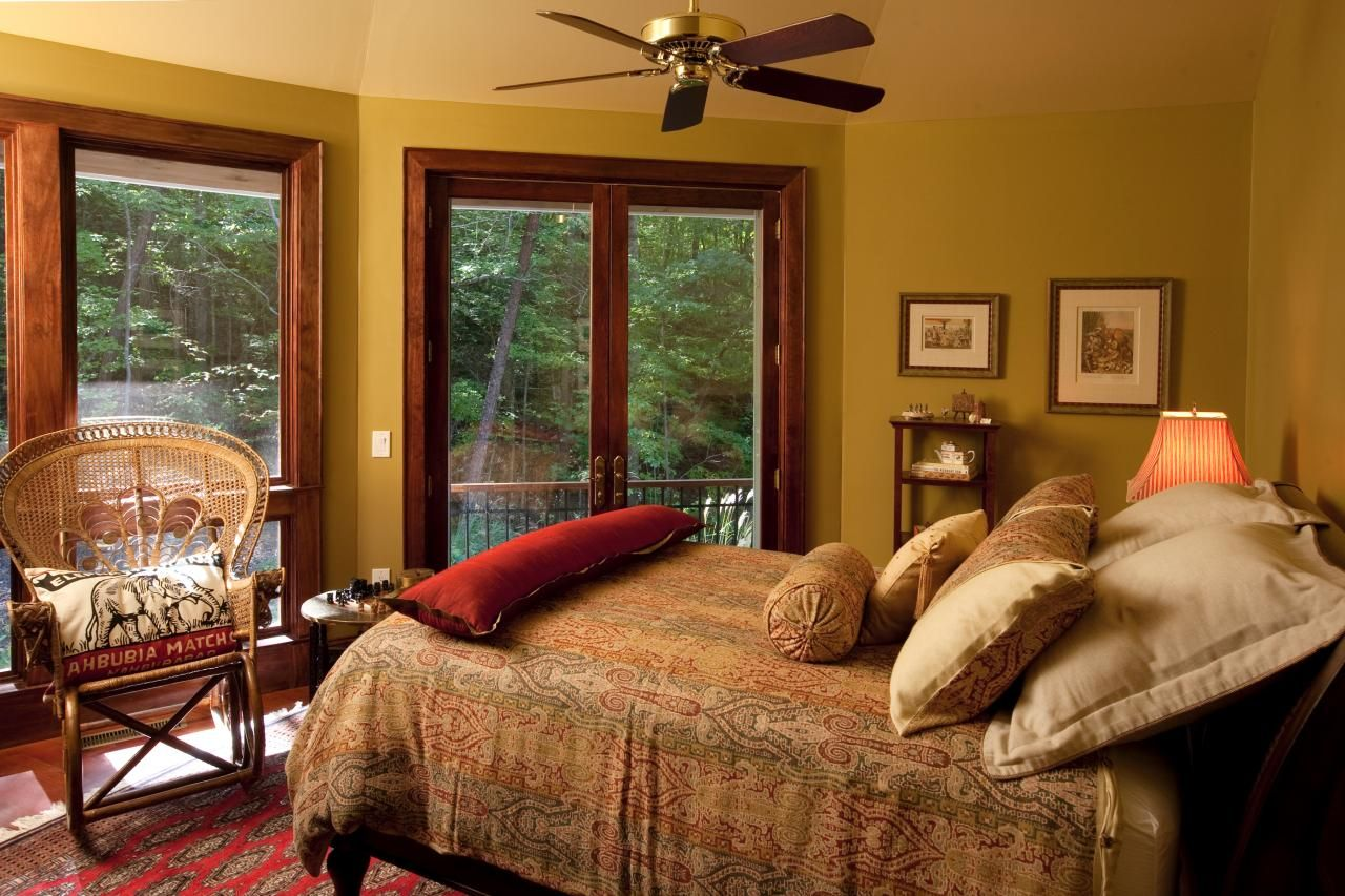 Master bedroom green  French doors lead to a balcony off of this cozy green bedroom A