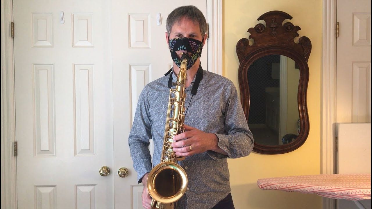Face mask with flap for playing wind instruments diy
