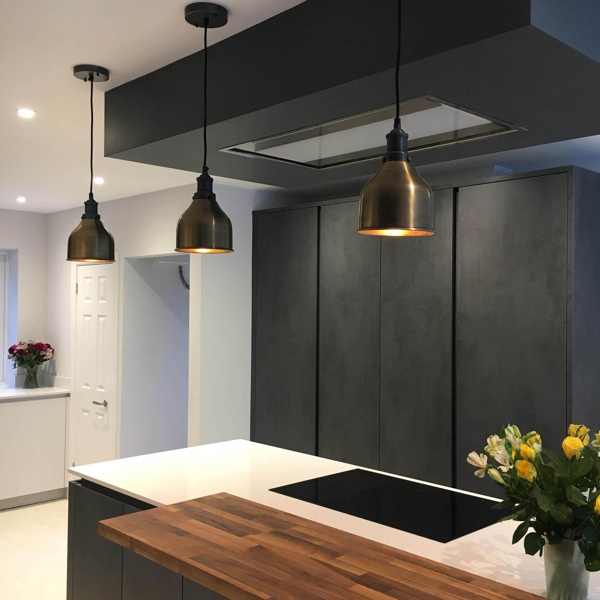 Dark kitchen interior with industrial lights over kitchen island ...