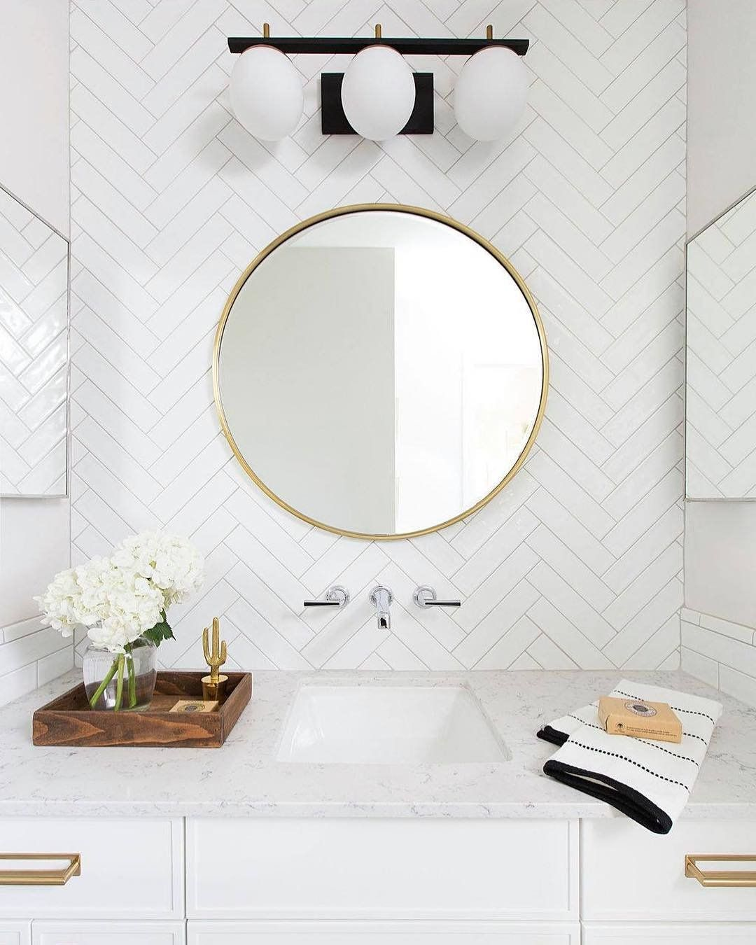 This Bright Bathroom Makes Great Use Of Proportion And Varying Shapes The Round Wall Sconce Light Round Mirror Bathroom Bathrooms Remodel Bathroom Inspiration