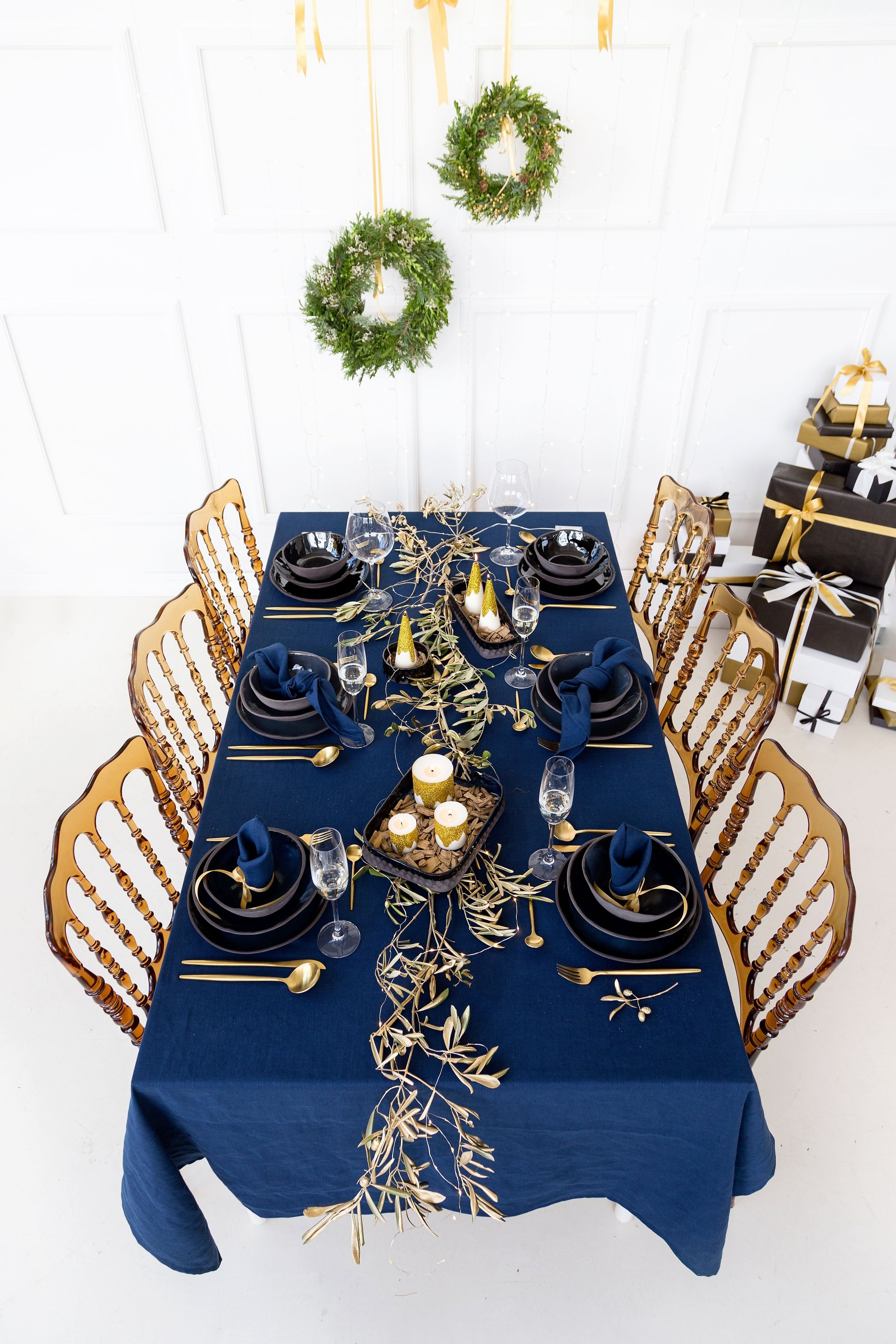 Navy blue Christmas tables cape with gold glitter soy wax candles | christmas table settings blue and gold #christmas #christmasgiftideas #christmasgift #christmasdecorations #christmasmood #christmasspirit #christmasshopping #christmasdecor #christmasinspiration #holidaydecor #christmasdining #christmasentertaining #cozychristmas #itsbeginningtolookalotlikechristmas