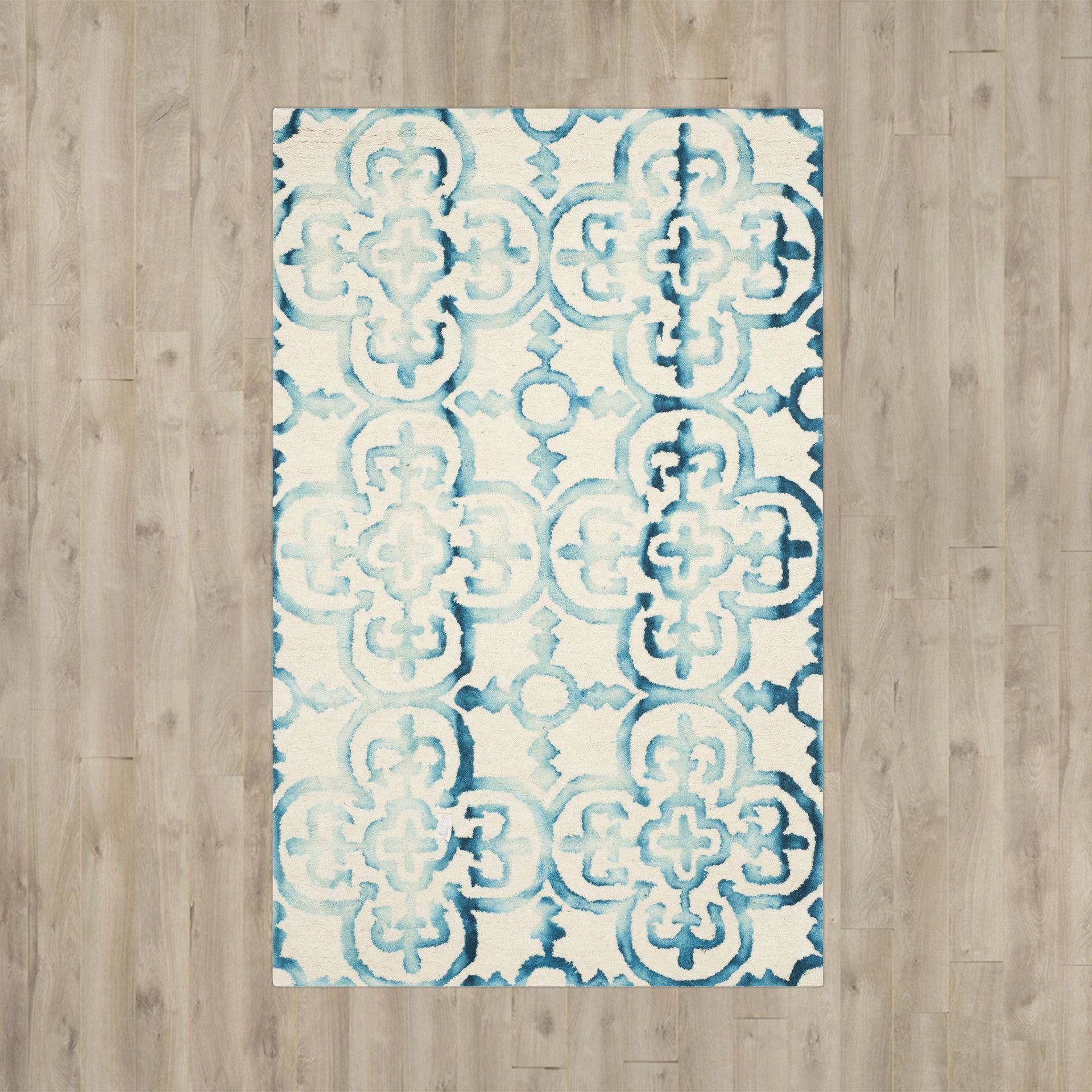 Kinzer Hand-Tufted Ivory/Turquoise Area Rug