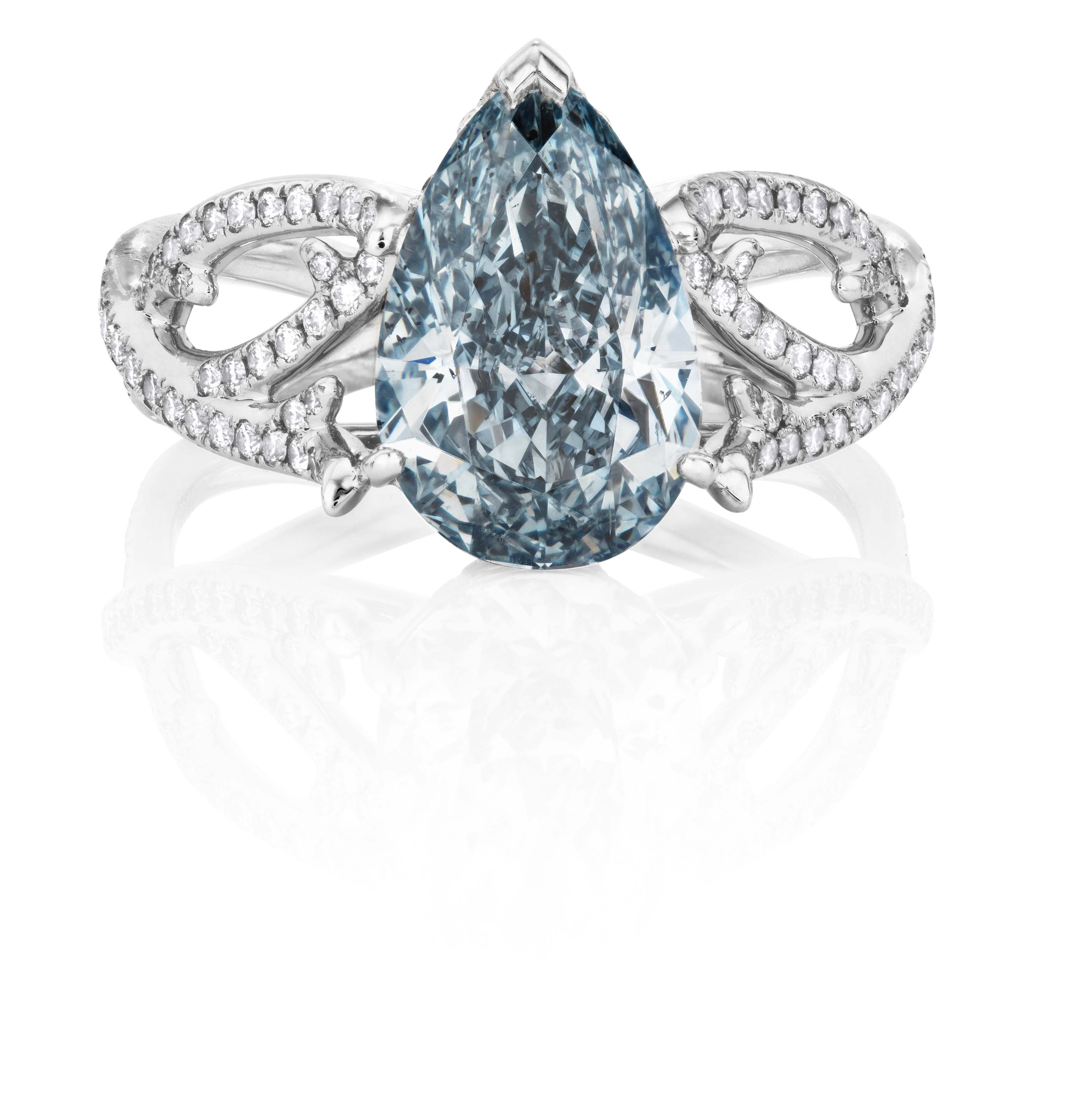 De Beers 1888 Master Diamonds Volute ring featuring a pear-shaped blue diamond solitaire