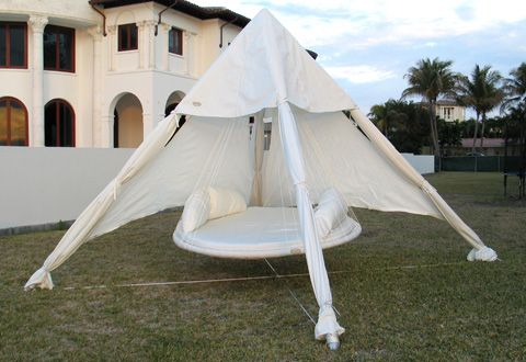 Outdoor Floating Bed floating bed with outdoor canopy and it's in a pyramid, too