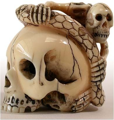 NETSUKE......ANTIQUE IVORY OF SKULL....PARTAGE OF THIERRY CHEVILLARD.....