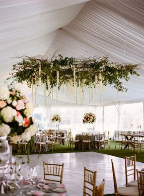 Floral chandelier over the dance floor makes a stunning focal point
