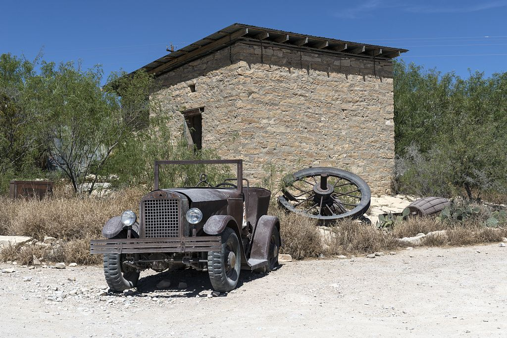 An Old Jalopy Outside An Abandoned Stone Building In The Ghost Town Some Of Which Is Still Occupied And Some Of Which C Abandoned Ghost Towns Mining Company