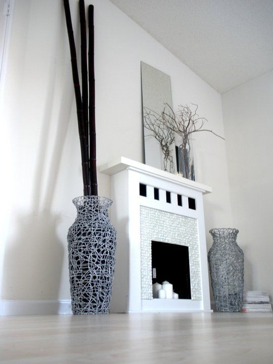 Faux Fireplace Ideas and Projects • Lots of Ideas and Tutorials! Including, from 'apartment therapy', this cool and modern faux fireplace project.
