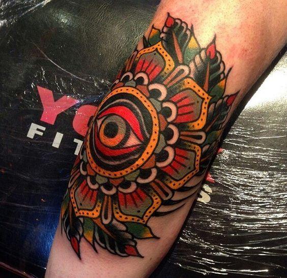 Traditional-Eye-In-Flower-Tattoo-On-Elbow-By-Luke-Jinks.jpg (564×547)