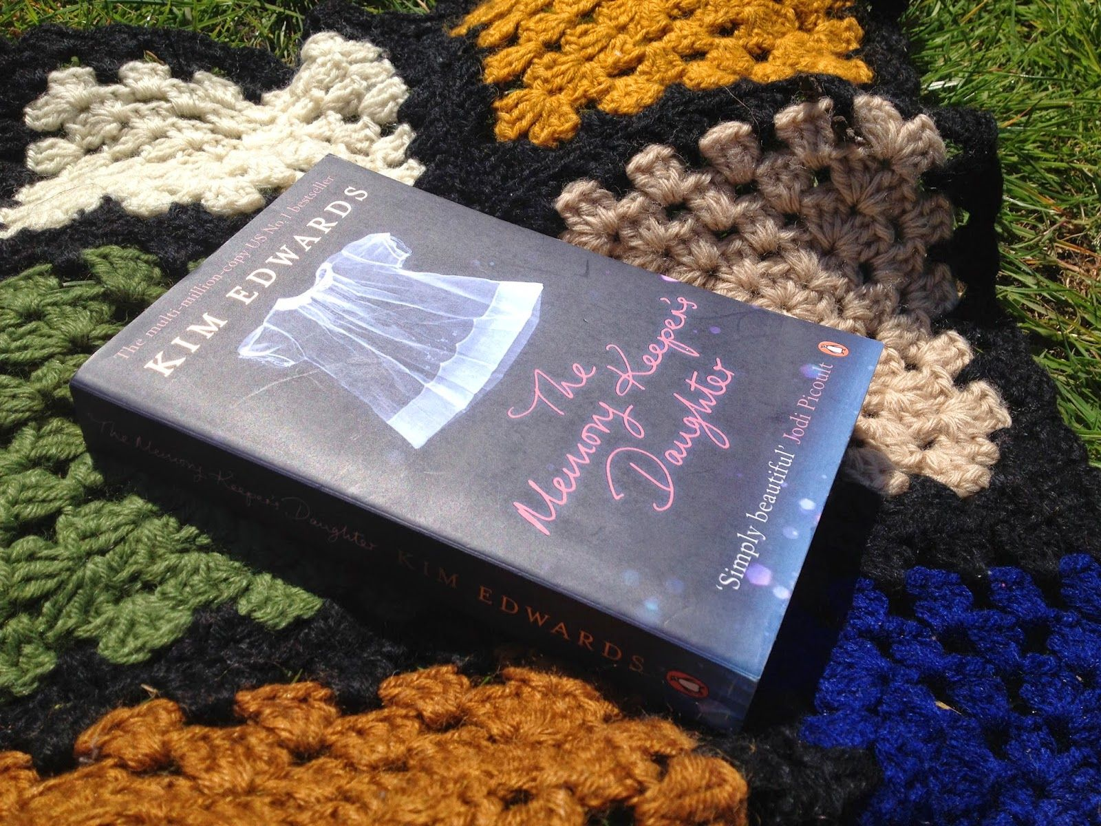Reading in the sun... My husbands grandmother made the blanket.