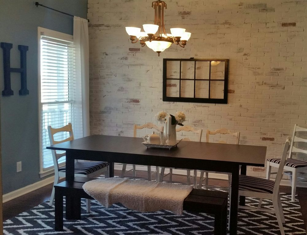 A husband and wife redo their dining room They hang faux brick - paneles para pared