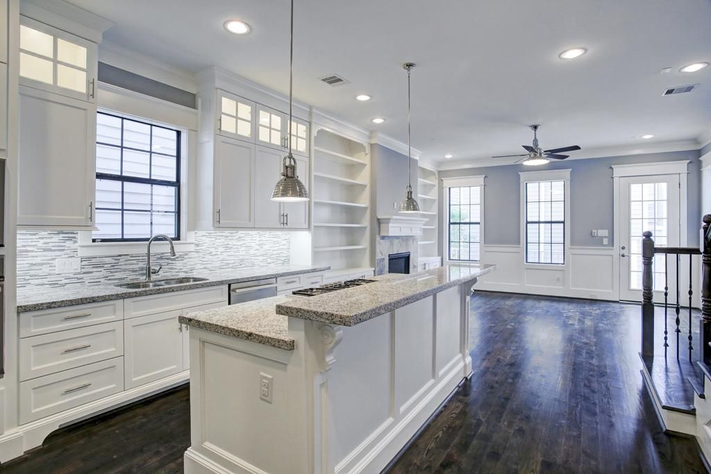 The Kitchen Features Himalaya White Granite, Under Cabinet Lighting, Subway  Tile Backsplash, Single