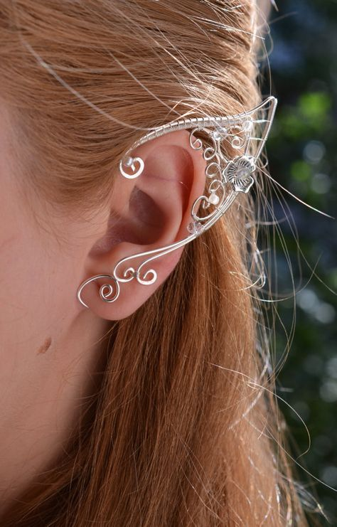 Elf Ears Ear Cuffs  Elven Ear Cuff  Boho Jewelry Bohemian Floral Freespirit is part of Ear cuff, Elf ears, Elf ear cuff, Ear jewelry, Bohemian jewelry, Boho jewelry - Handmade bright and tender elfear ear cuffs  Price is for two cuffs  PIERCING IS NOT REQUIRED                                                                          → Delivery time •UK 510 business days •EU 510 business days •USA, Canada, Australia 1020 business days Please contact me before placing an order if it needs to be delivered by a certain date!                                                                          → Materials •silver plated wire (nonallergenic) •Czech glass, lead crystal, pearls