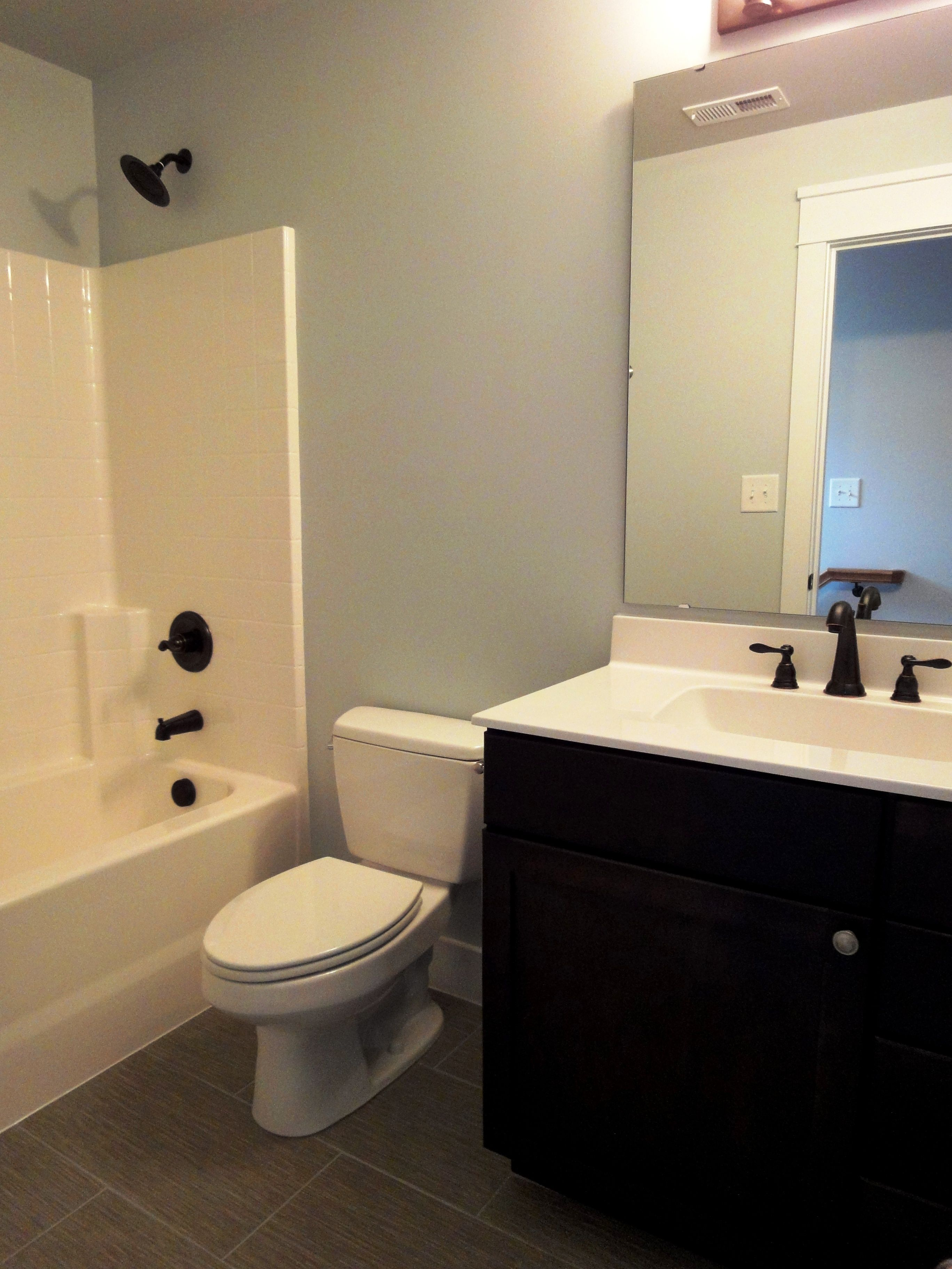 Photo of Upstairs guest bathroom. Like the idea o replacing the bathroom fixtures