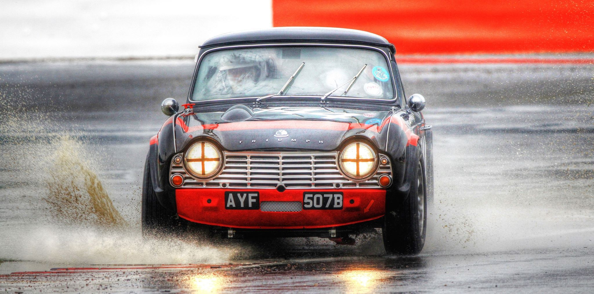 This pic really is loaded with energy. One TR4 under heavy circumstances in the Equipe GTS at Brands Hatch in 2015. © Peter French.