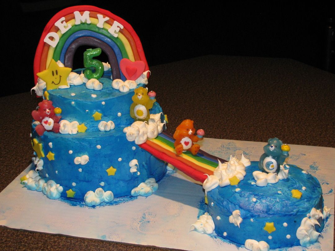 Care Bears Cake... lots of frosting, rainbows are made from fondont and completely dried 'til hard and stiff before placing on cake, the little Care Bears were actually candles I bought.