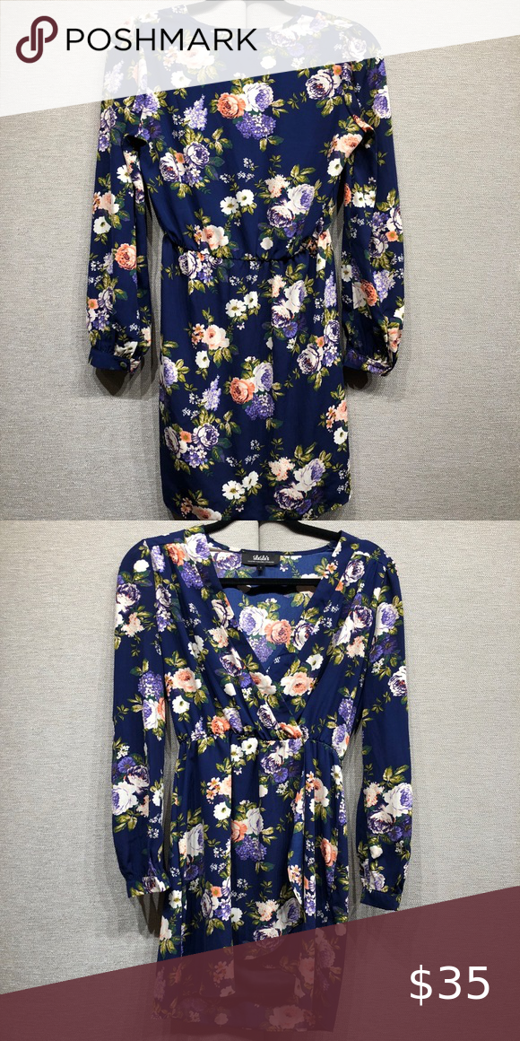 5b9d29336493 Navy Blue Floral Dress Super cute long sleeve wrap dress. Elastic waste  band. Navy blue floral print. Worn once. Lulu's Dresses Long Sleeve