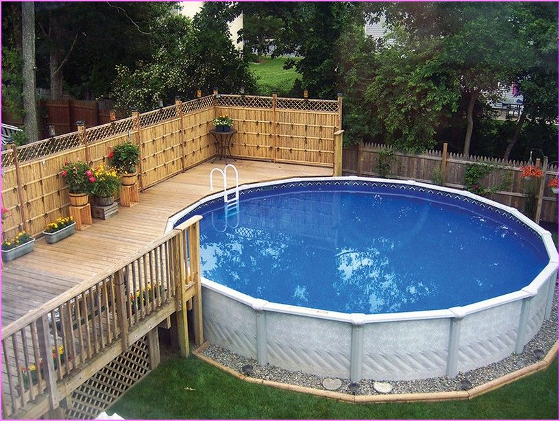 Landscaping around above ground pool back yard pool for Above ground pool decks for small yards
