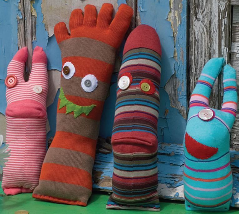 DIY Sock Monsters - Don't throw your odd socks away. Instead, transform them into monsters! Simply stuff the socks and sew funny features onto them to make a wh...