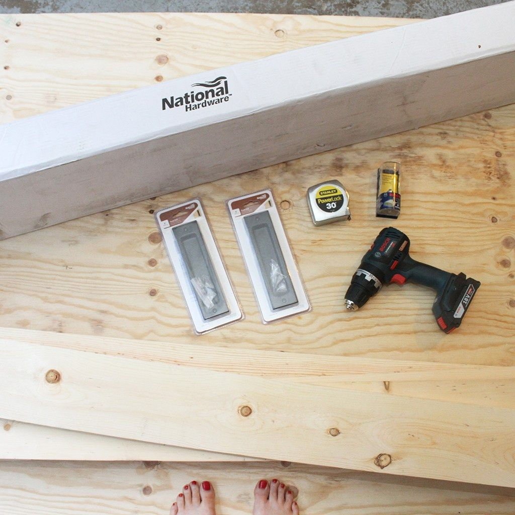 Blogger Oh So Lovely builds her own interior barn door, and uses ...