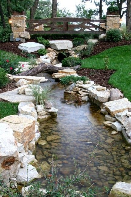 20 outstanding natural garden stream designs that will for Natural backyard pond