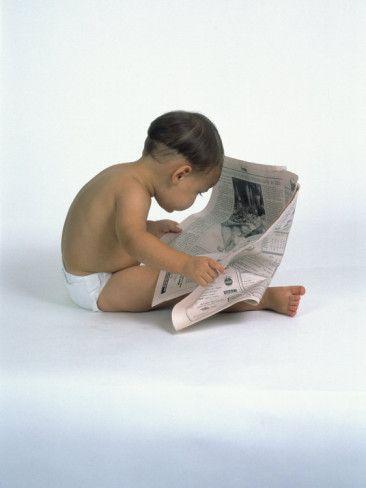 Baby Reading Newspaper