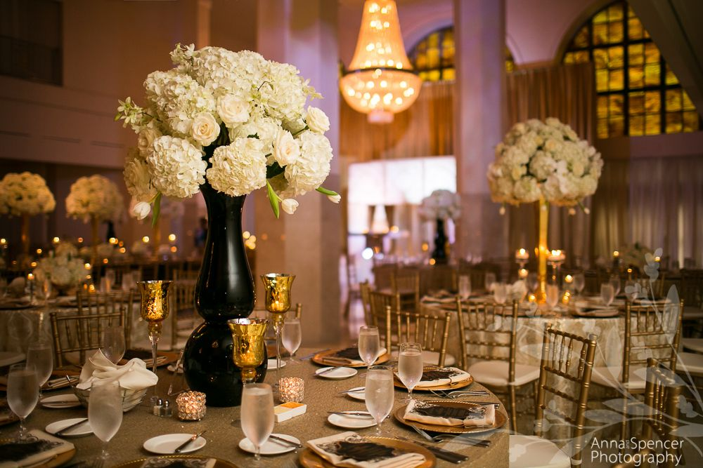 Gold, black, and white ballroom wedding reception in ...