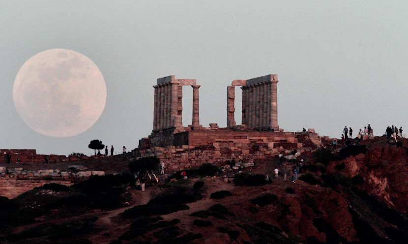 """The """"supermoon"""" rises behind the Temple of Poseidon in Cape Sounion, south east of Athens, Greece - 5/5/2012"""