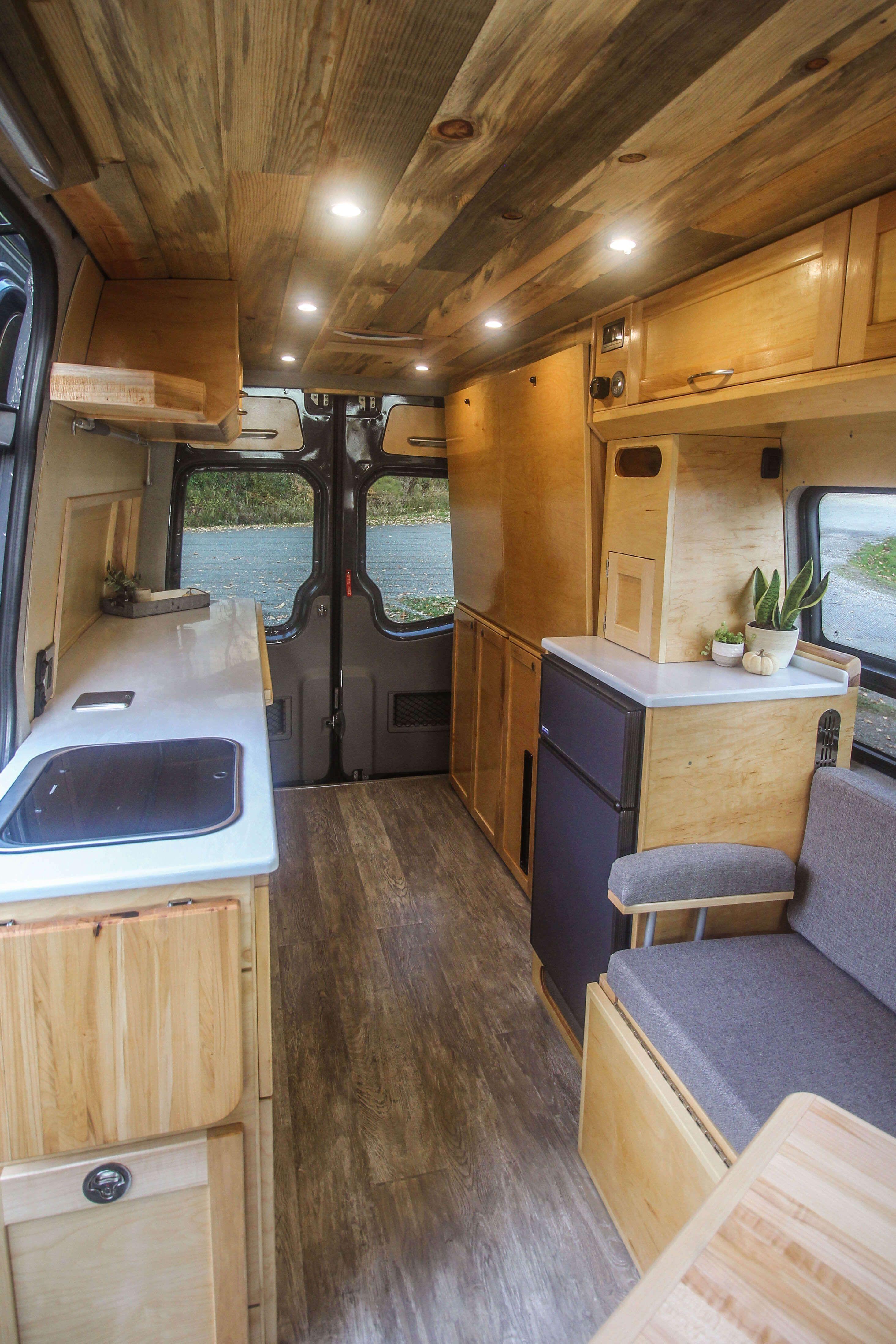 Photo of Sprinter conversion with 2-panel drop down Murphy bed by Freedom Vans. #van #van…