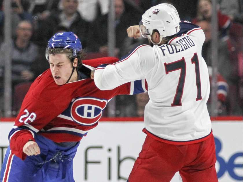 Montreal Canadiens Nathan Beaulieu, left, fights with Columbus Blue Jackets Nick Foligno during National Hockey League game in Montreal Tuesday December 1, 2015.