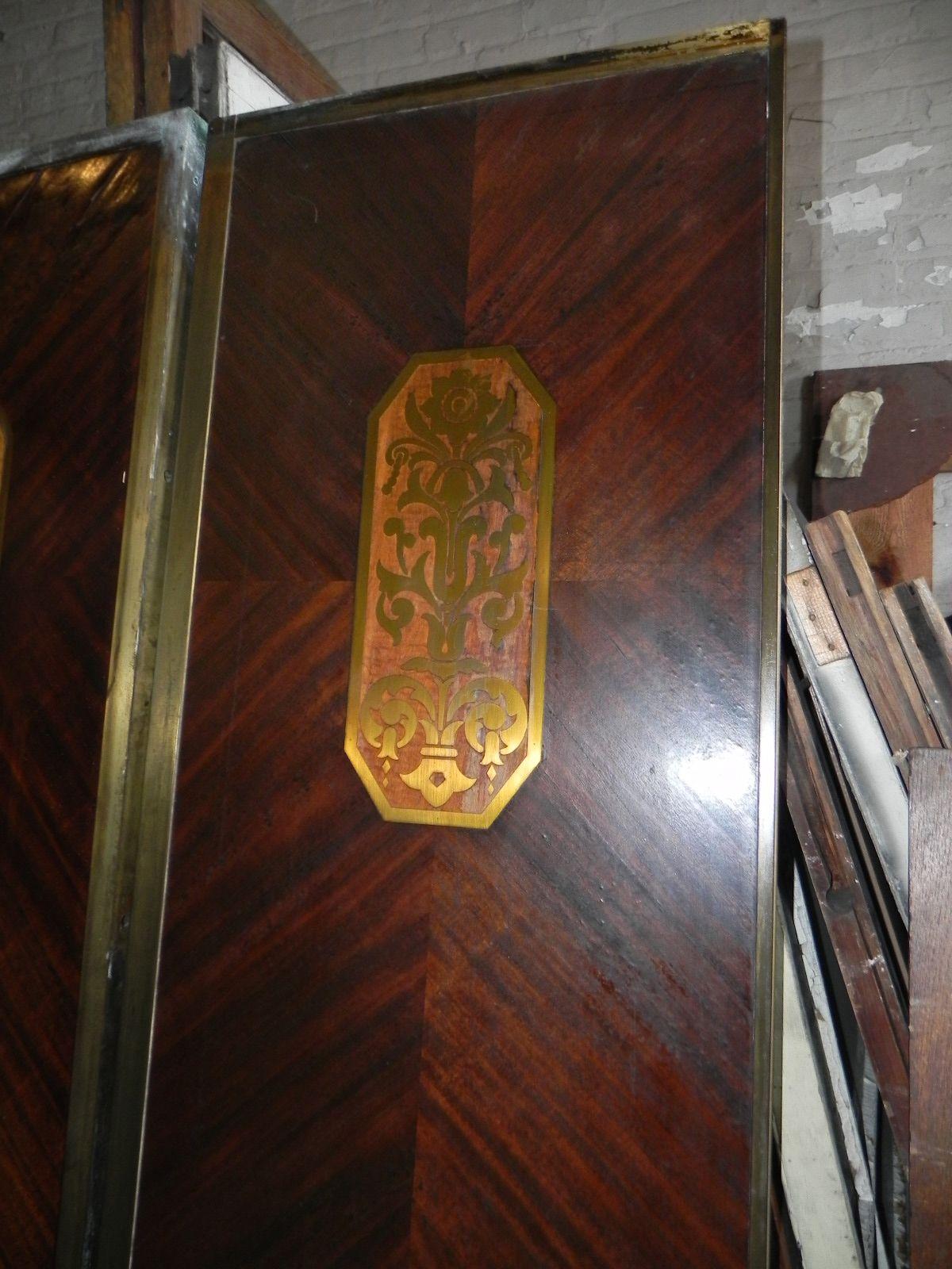 Art deco mahogany elevator door with lace wood brass boule work